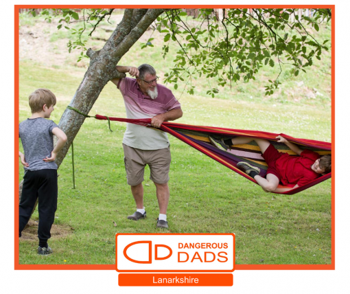 IMage to show a dad and 2 children playing together